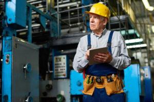 Senior Factory Worker Using Tablet