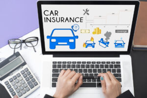 business hand using computer with car insurance policy page. concept accident prevention coverage.